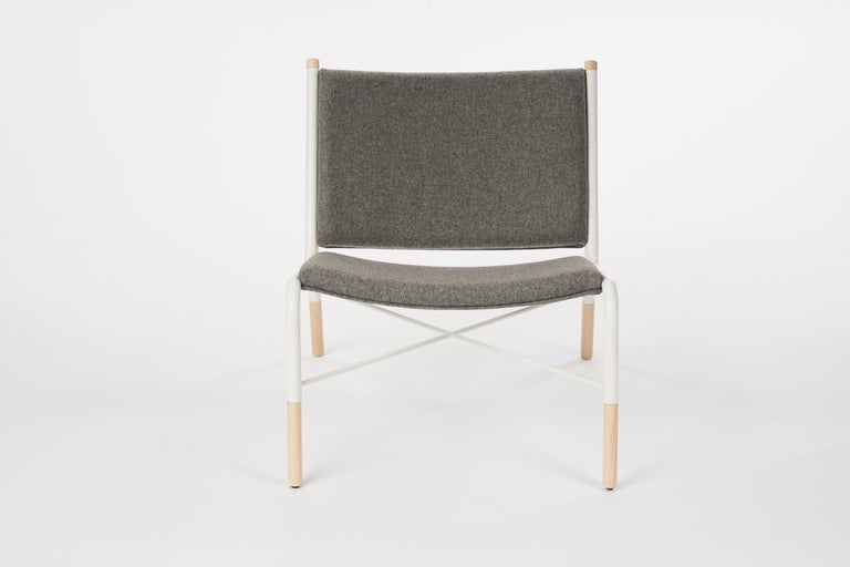 Frame: Laser-cut, welded cold-rolled steel frame. Custom eco-friendly matted powder-coat finish.   Cushion: The cushion is made from premium Italian melton wool cloth for a felt-like feel.  Details: Commercial grade COFO Signature laser cut