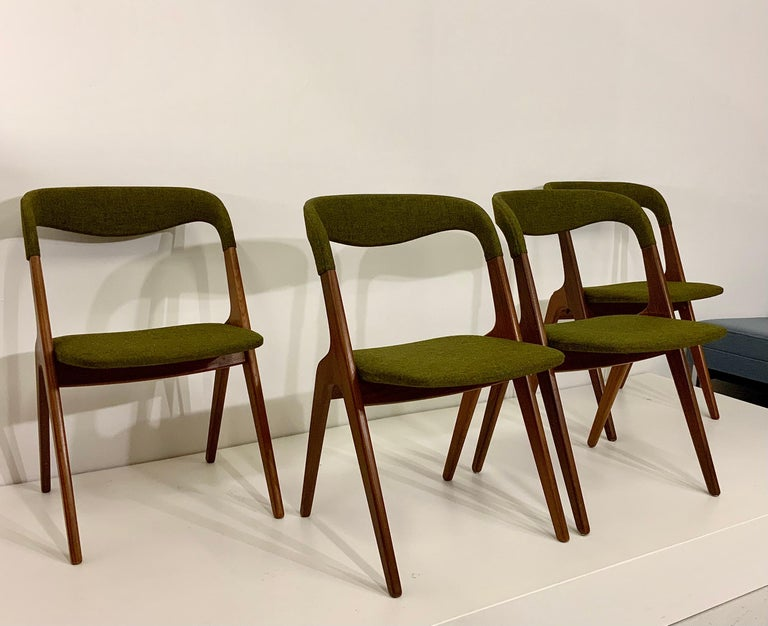 This offer is for a set of four very rare vintage sculptural Danish design classic diningchairs.  + Classic Danish Scandinavian Modern upholstered iconic chairs with frame in solid teakwood, well padded and with solid structure. + Fabric cover