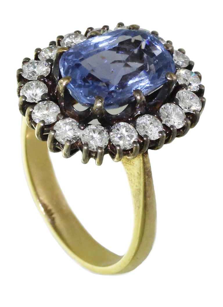 5Ct Blue Ceylon Sapphire with Diamonds on  Yellow Gold Engagement, Wedding Ring  Natural 5Ct Ceylon / Ceylan Sapphire. Natural color and Gemstone. 18K color Gold  The ring is a size 6.75, sizable. Please indicate your ring size wen