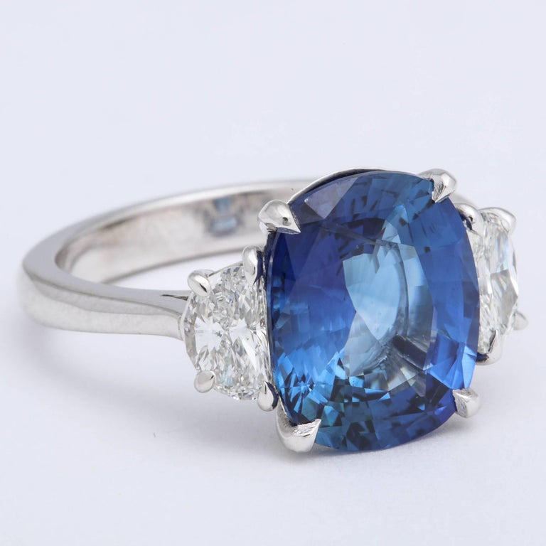 Stunning 5.22 carat GIA certified Cushion cut Blue Sapphire and Diamond Ring   .78 carats of half moon diamonds  A beautiful sapphire and cut -- full of sparkle!  Set in platinum  This ring is currently a size 6. It can easily be resized to any