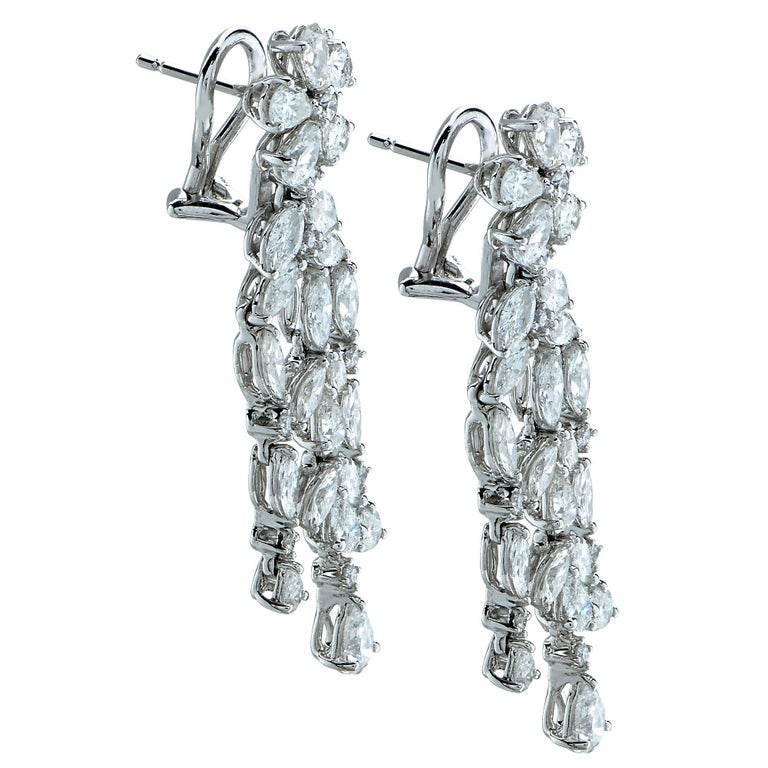 Dazzling diamond dangle earrings comprising a stunning collection of 62 round brilliant cut, marquees cut and pear shape diamonds, with a total estimated weight of approximately 5 Carats, set in 18k white gold.   Our pieces are all accompanied by an