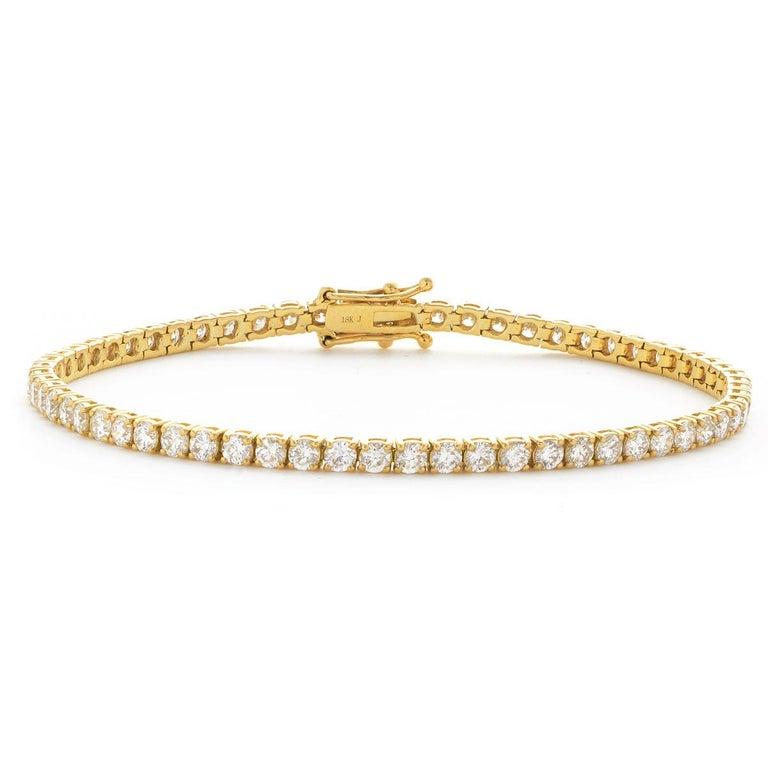 Modern 5 Carat Four Prong Round Diamond 18 Karat Gold Riviera Line Tennis Bracelet For Sale