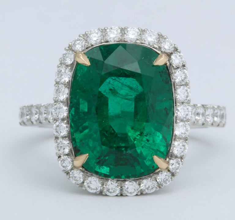 A beautiful Green Emerald cut in an elongated cushion shape!!  5.21 carat cushion cut emerald with ZERO treatment -- NO OIL as stated on the GIA certificate.   This completely natural beauty is set in an 18k yellow gold and platinum diamond setting