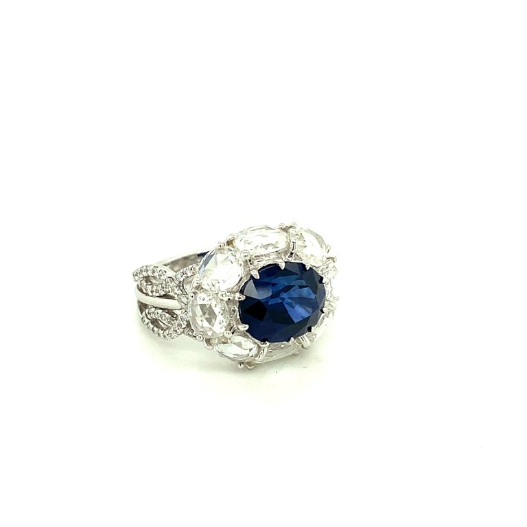 5 Carat GRS Certified Royal Blue Sapphire and White Diamond Gold Engagement Ring:  A stunning ring, it features a gorgeous GRS certified royal blue oval-cut sapphire weighing 5 carat surrounded by a halo of white rose-cut diamonds weighing 3.28