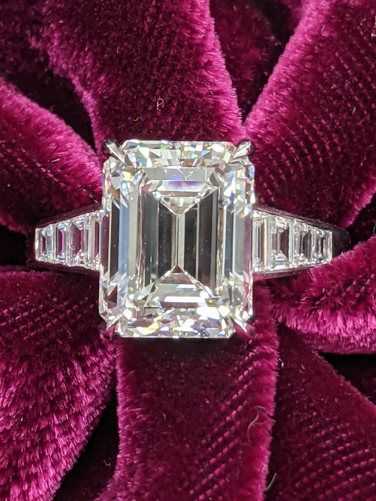 This emerald cut diamond ring is as exceptional as it looks, but looks even better on your finger.  The mounting is extremely hard to find because of the craftsmanship involved from the perfectly aligned and set flow of trapezoids to the seamless