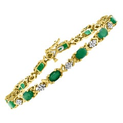 5 Carat Emerald Tennis Bracelet 10 Karat Yellow Gold with Diamond Accent
