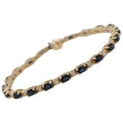 5 Carat Oval Cut Blue Sapphire and 1 Carat Diamond Straight Line Bracelet