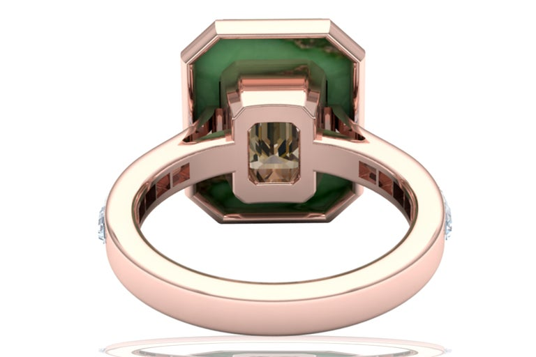 Stunningly beautiful, this center stone looks something like a diamond.  This rich cognac brown sapphire emerald cut makes this ring look like it belongs in a museum.  Being over 3 carats and cut to perfection, this brown sapphire radiates classic
