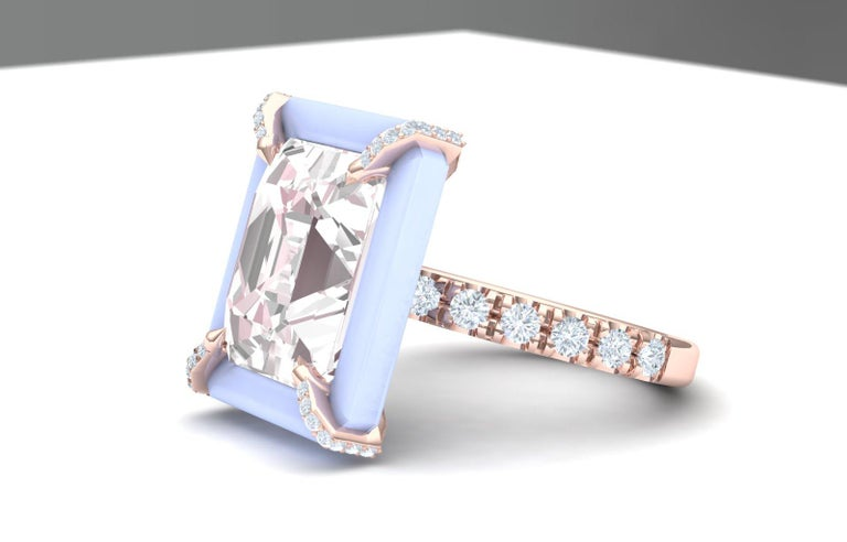 A beautiful play on pastel color ranging from warm blush to cool periwinkle.  The center stone is just over 4 carats of blush color Morganite.  The center stone is complemented by a custom cut halo of Chalcedony and over .50 carats of round
