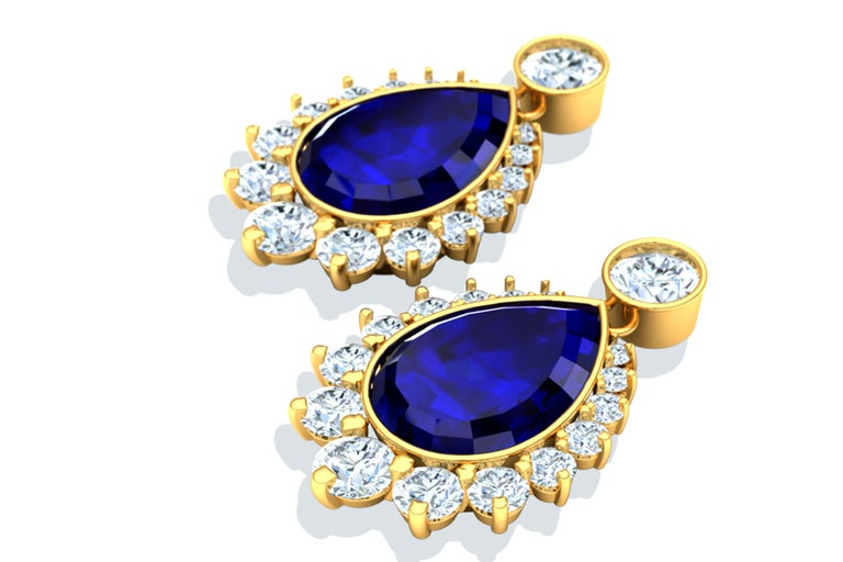 These drop Tanzanite and diamond earrings contain the following.  Two pear cut AAA Tanzanites that are deepest hues of violet and blue with peaking amounts of red when the light hits it right.  These pear shape Tanzanites are complimented by over