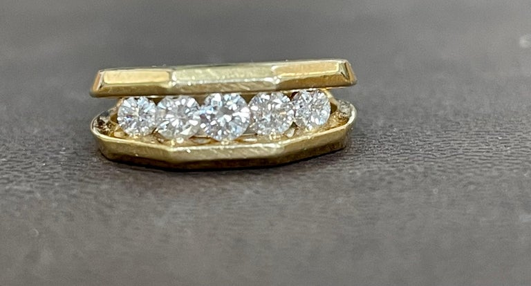 5 Diamonds Unisex 1-Row Diamond Yellow Gold Band Ring in 14 Karat Gold Size 7 This is a open setting or channel setting ring from our premium wedding collection. 5 round diamonds VS quality are set in a row in 14 karat yellow gold . Ring size 7, it