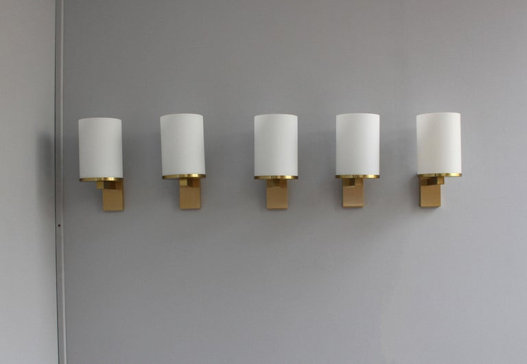 Atelier Perzel - Five fine French Art Deco wall lights with an enameled glass cylinder shade mounted on a bronze base. Price includes US re-wiring.