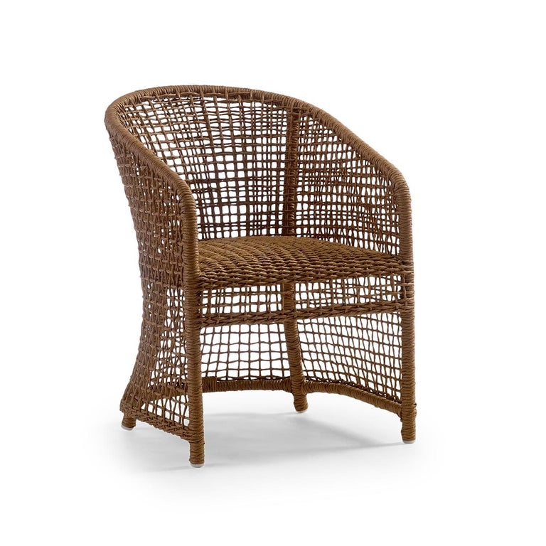 A transitional outdoor dining collection composed of 4 dining chairs and one dining table. Each chair features all-weather woven resin wicker in a natural finish with a powder coated metal frame. Each upholstered component is integrated with