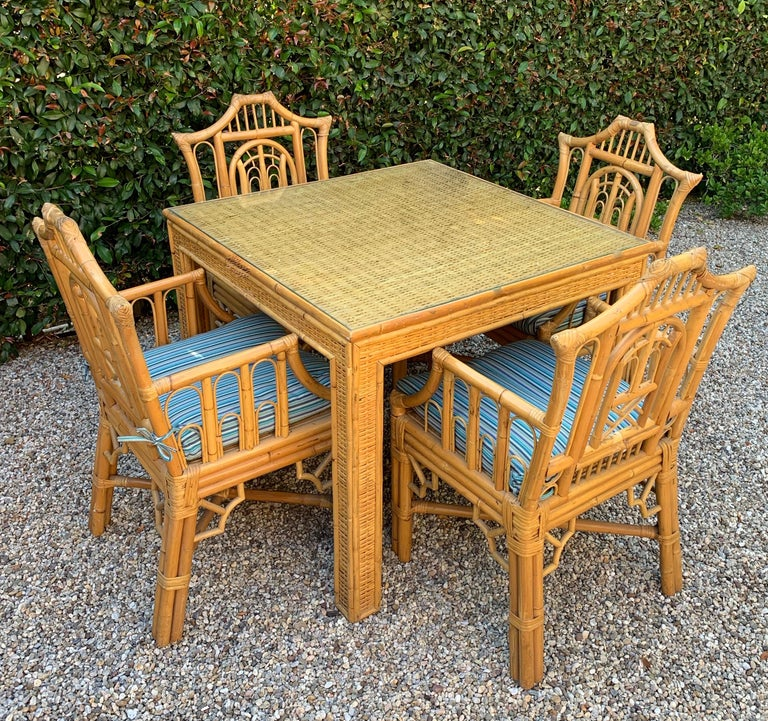 5-piece Chinese Chippendale style bamboo game table or dining table and armchairs with regency influences, an exceptional set of uniquely designed chinoiserie Chippendale chairs in Pagoda style, all with arm and Sunbrella Brand striped cushions,