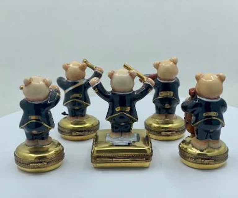 Very charming and whimsical, fine quality Limoges France porcelain teddy bear orchestra trinket box set featuring exquisitely detailed band members dressed in matching uniforms. Set includes the conductor or band leader, Cello player, violinist,