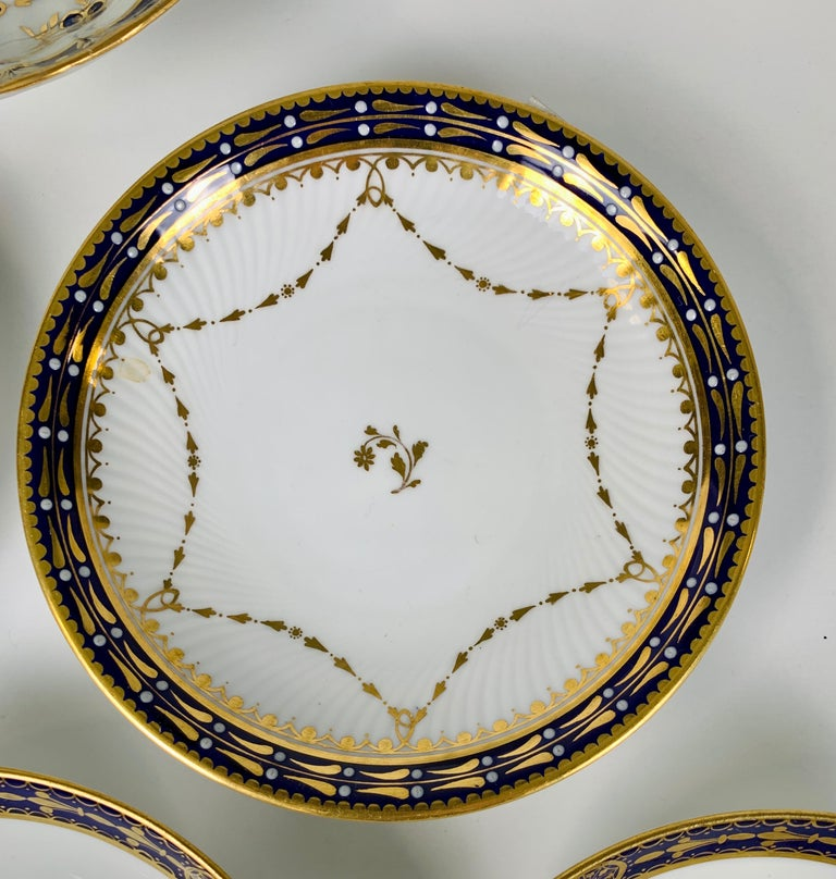 5 English porcelain saucers with cobalt blue gilded borders made England 19th and 20th centuries.