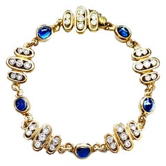 5 Sapphire Cabochon and 35 Diamond Bracelet in Yellow and White 18 Kt Gold