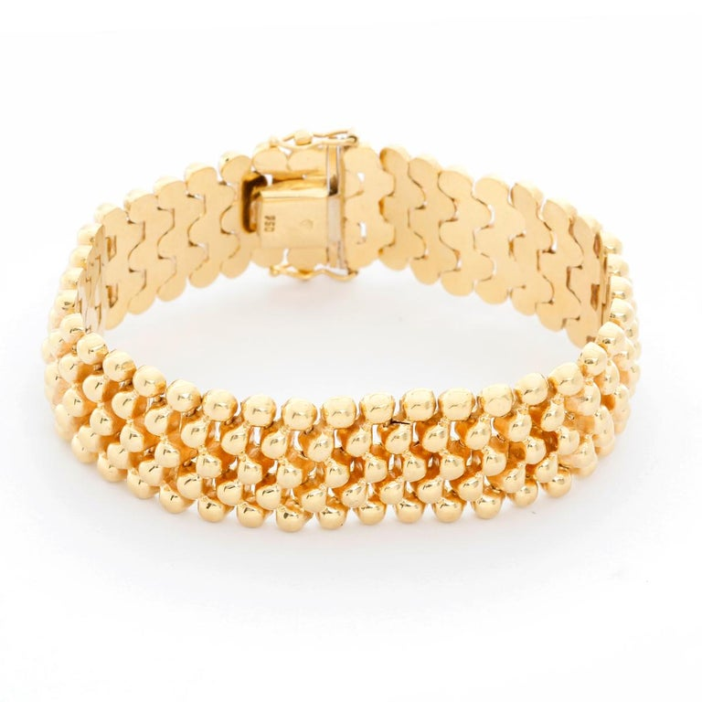 5 Strands Gold Bead Bracelet  - This bracelet features 5 strands of 18K yellow gold beads. Weighs 34.30 grams and is 6.35 inches and 5/8 inch wide. Pre-Owned with box. .