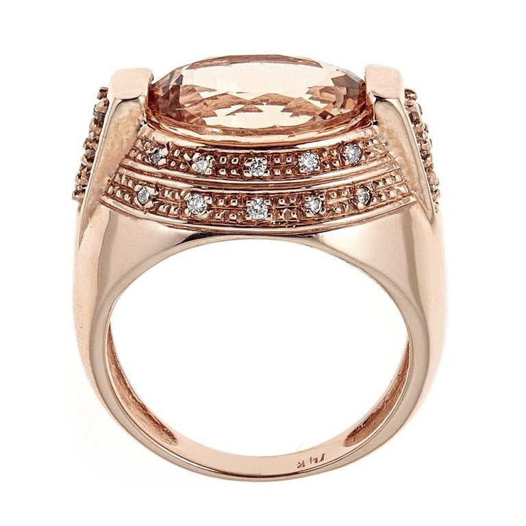 Handcrafted in 14K rose gold, this ring features a 5 carat morganite with round brilliant diamonds.