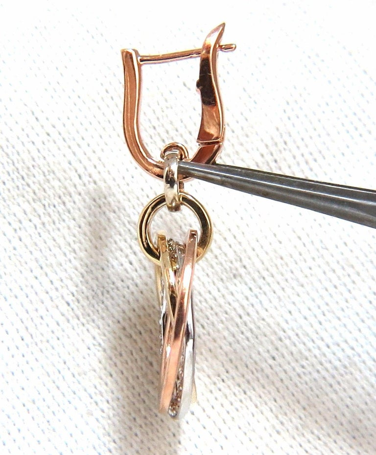 Rolling Rings circle loop earrings.  The Modern Dangle.  .50cts of natural round diamonds:   G-color, Vs-2 clarity.  14kt. white / yellow / rose gold  8.7 grams.  Earrings measure: 1.23 inch long   .63 diameter on each ring  Comfortable Lever snap