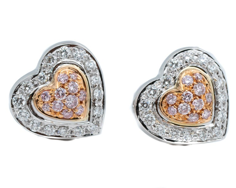 Beautifully crafted double heart shape diamond earrings featuring natural fancy pink and white diamonds. Made in 1990s, these are push back earrings that feature two-tone 18 karat gold, the perfect blend of white and rose gold!  Earring