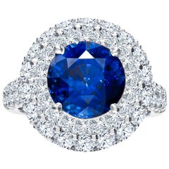 5.00 Carat Round Natural Blue Sapphire and 2.63 Carat Total Diamond Ring, 18K