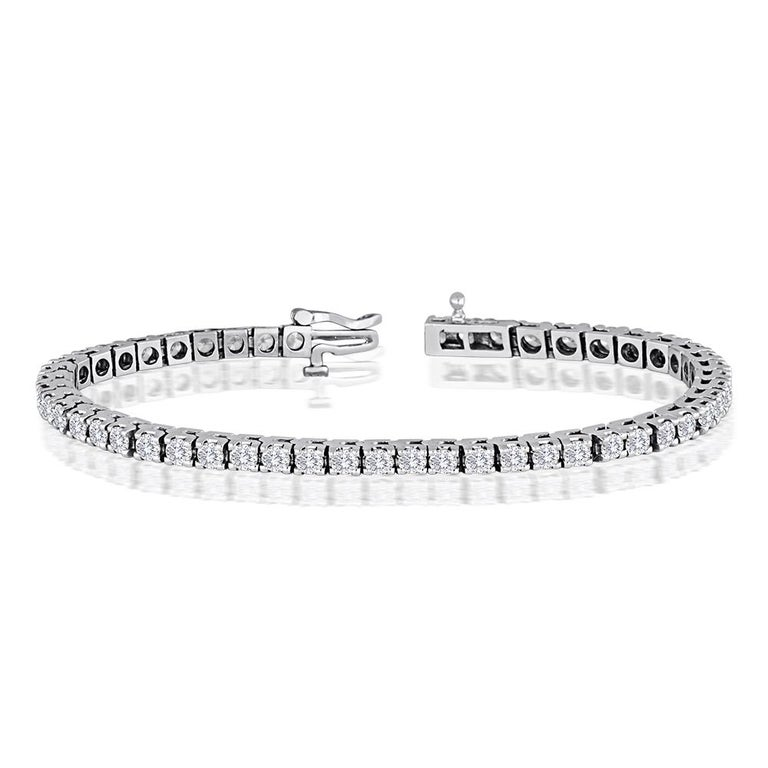 Sparkling Diamond Tennis Bracelet The Bracelet is 14K White Gold. There are 5.00 Carats in Diamonds F/G VS/SI This is a 4 prong setting. The bracelet is 7″ in length. There are 50 stones. Each diamond is about 0.10 Carat The bracelet weighs 16.5