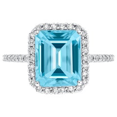 5.00ct Emerald Cut Blue Topaz 0.38 Carat Diamond Halo 18 Karat White Gold Ring