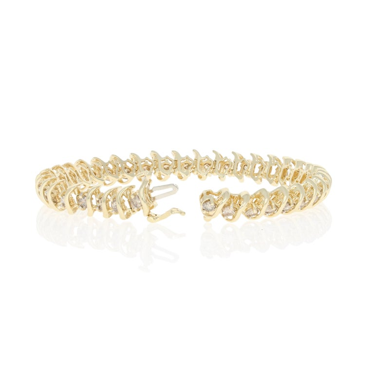 Metal Content: Guaranteed 14k Gold as stamped  Stone Information:  Natural Diamonds   Clarity: SI2 - I1  Color: Q - R (champagne brown)   Cut: Round Brilliant Total Carats: 5.00ctw   Bracelet Style: Tennis Measurements: length 6 1/2