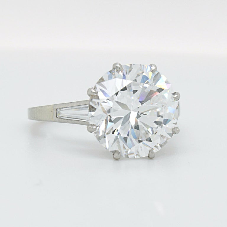 A stunning diamond round brilliant solitaire ring in white gold and platinum. The big centre stone is set in an alluring way showcasing its icy white colour from every angle - a treat of purity for the eyes.   The centre diamond weighs 5.02 carats,