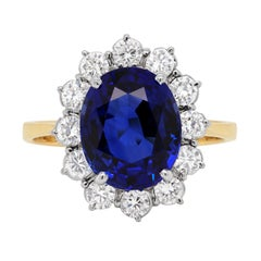 5.03 Carat Blue Sapphire and Diamond 18 Carat Gold Cluster Engagement Ring
