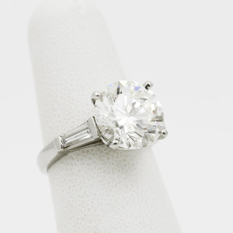 Modern 5.03 Carat GIA Round Cut Diamond Platinum Three-Stone Ring
