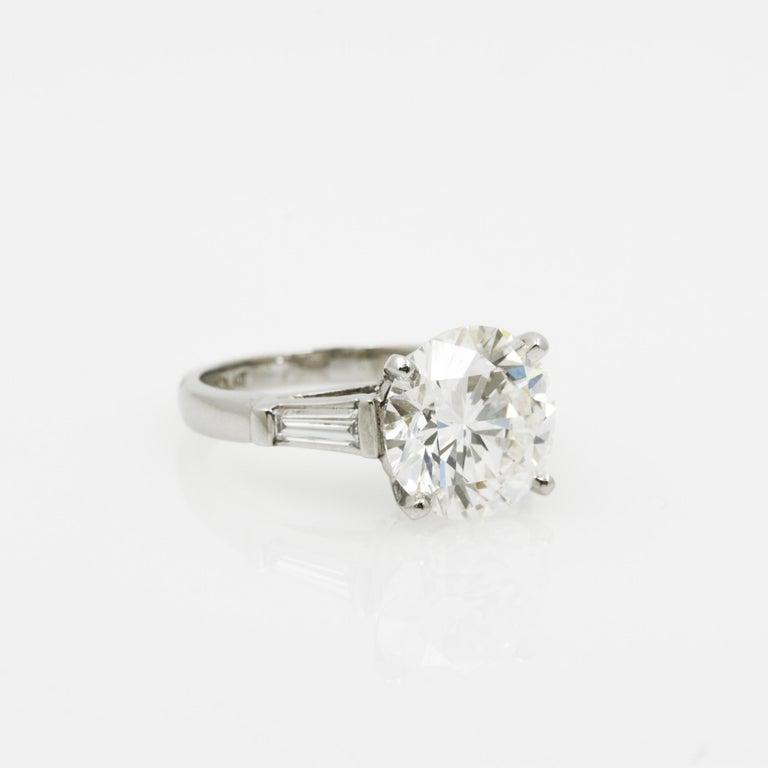 Brilliant Cut 5.03 Carat GIA Round Cut Diamond Platinum Three-Stone Ring