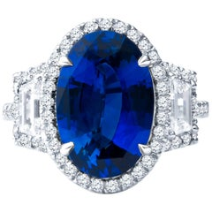 5.04ct Oval Sapphire with 0.68ctw Step Cut Trapezoid & 0.50ct Diamond Halo Ring