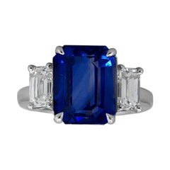 5.05 Carat Emerald Cut Blue Sapphire and Diamond Three-Stone Engagement Ring