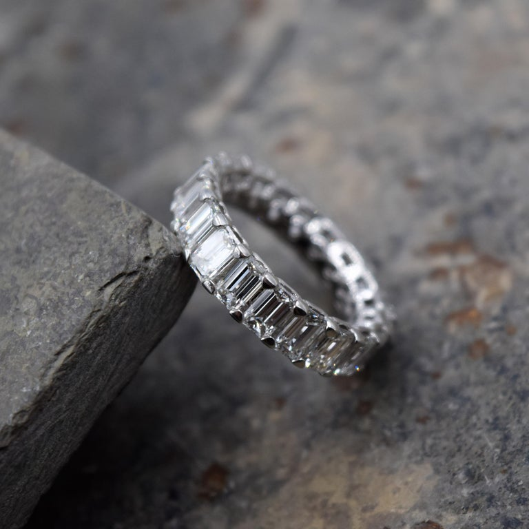 Beautiful Diamond Band by Elliott Chandler. 20 emerald cut diamonds totaling 5.06 carats are prong set in a platinum setting. The size of this ring is 5 and can not be sized.