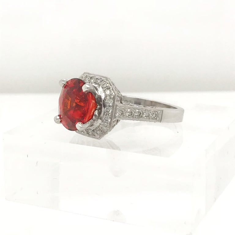 Women's or Men's 5.06 Carat Oval Cut Spessertite Garnet and Diamond Ring set in 18 Karat Gold For Sale