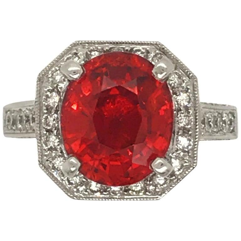 5.06 Carat Oval Cut Spessertite Garnet and Diamond Ring set in 18 Karat Gold For Sale