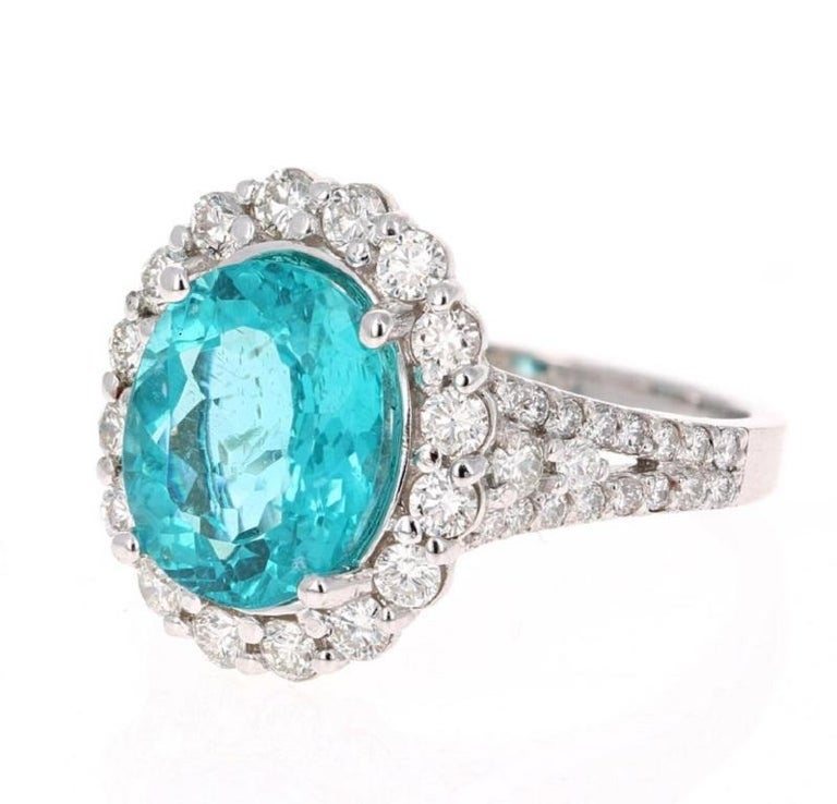 Stunning 5.07 Carat Apatite Diamond White Gold Bridal Ring that is sure to elevate your accessory collection or it can even be a great substitute for an Engagement Ring!  The ring has a 3.96 carat Oval Cut Apatite set in the center of the ring