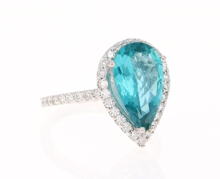 An amazingly deep and beautiful Apatite set in a gorgeous 14 Karat White Gold setting with Diamonds!   Apatites are found in various places around the world including Myanmar, Kenya, India, Brazil, Sri Lanka, Norway, Mexico and the USA. The sea blue