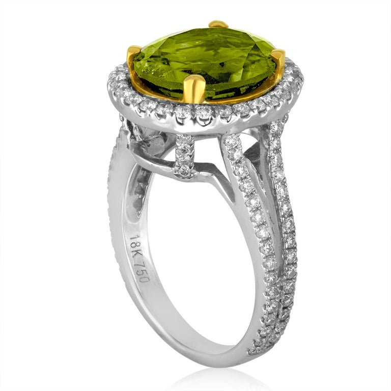 Beautiful Peridot Stone set in a Diamond Split Shank Halo Setting The ring is 18K White & Yellow Gold There is 1.00 Carat in Diamonds F VS/SI The center stone is an Oval Peridot 5.07 Carats The ring is a size 5.75, sizable The ring weighs 7.3 grams