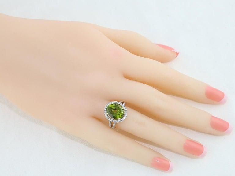 Modern 5.07 Carat Oval Peridot Diamond Gold Halo Ring For Sale