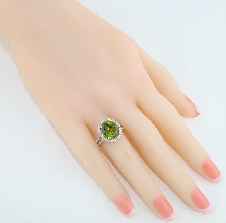 Oval Cut 5.07 Carat Oval Peridot Diamond Gold Halo Ring For Sale