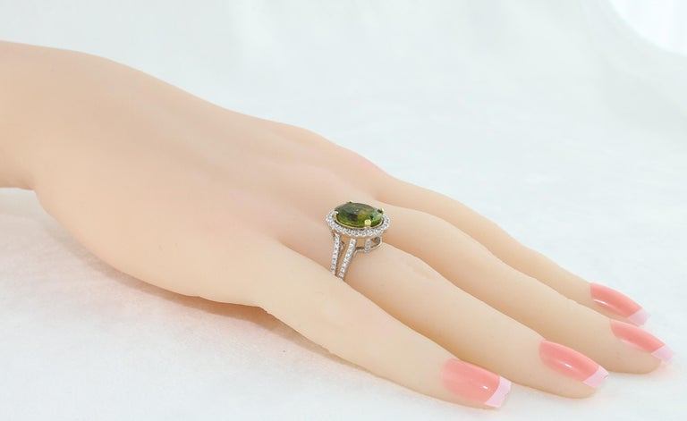 5.07 Carat Oval Peridot Diamond Gold Halo Ring In New Condition For Sale In New York, NY