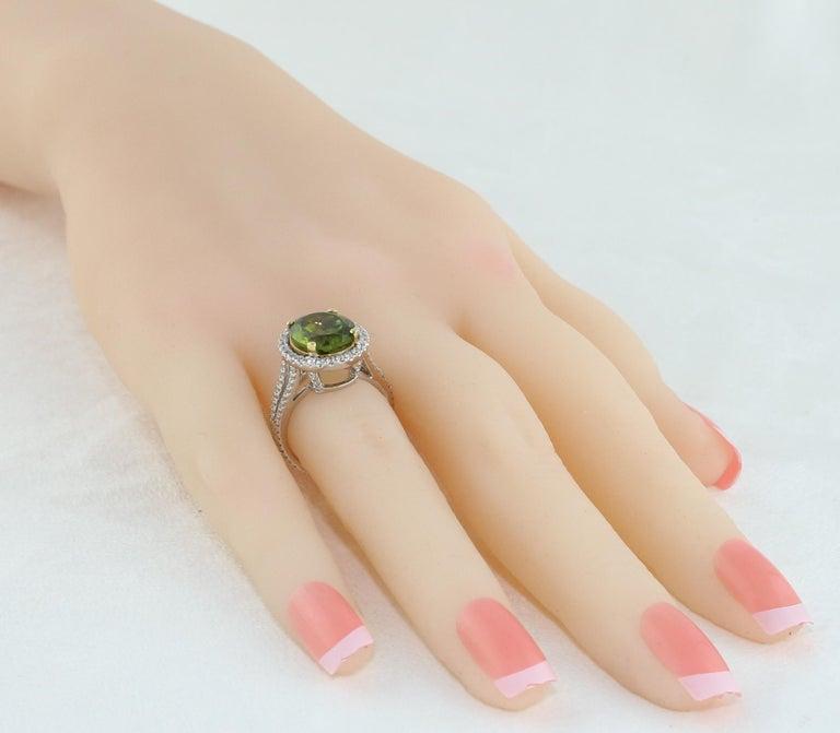Women's 5.07 Carat Oval Peridot Diamond Gold Halo Ring For Sale