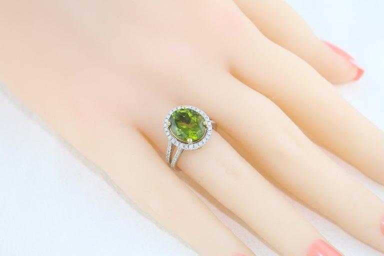 5.07 Carat Oval Peridot Diamond Gold Halo Ring For Sale 1