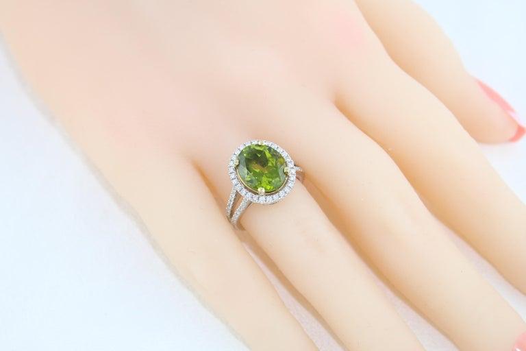 5.07 Carat Oval Peridot Diamond Gold Halo Ring For Sale 2