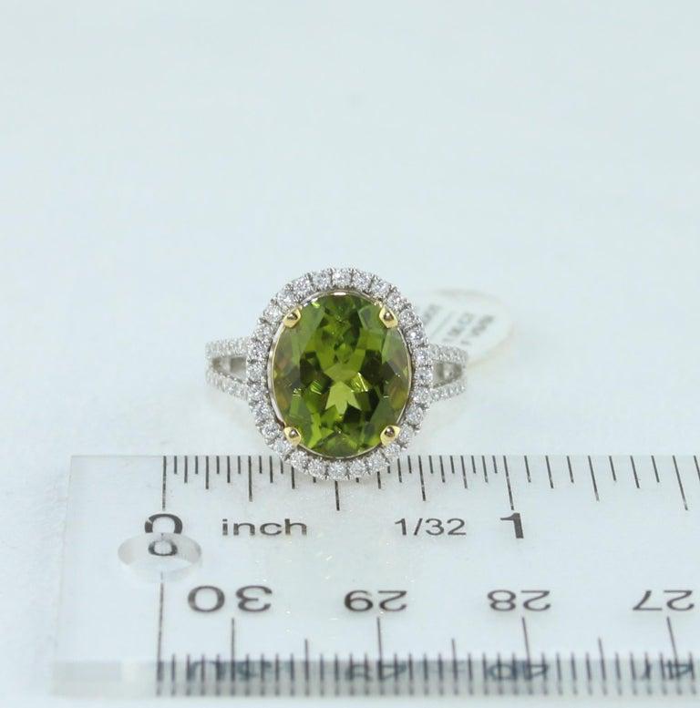 5.07 Carat Oval Peridot Diamond Gold Halo Ring For Sale 3