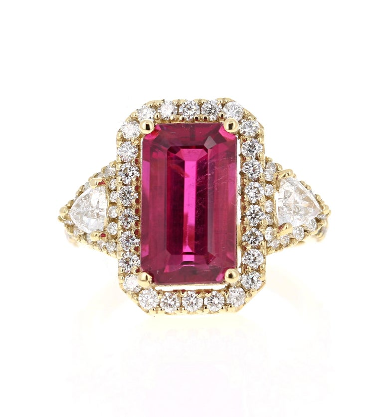 A beautiful statement piece that is sure to elevate your jewelry collection or serve as an Engagement or Cocktail Ring!  This beauty has a Emerald Cut Rubellite/Tourmaline that weighs 4.57 Carats and measures at 9 mm x 14 mm. It is surrounded by 2