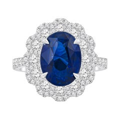5.09 Carat Natural Oval Blue Sapphire 'GIA' Flower Style Diamond Ring, 18 Karat
